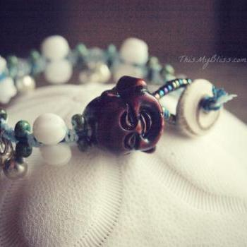 micro macrame Buddha bracelet with vintage beads & bells